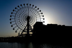 Silhouetted ferry wheel Royalty Free Stock Images