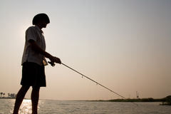 Silhouetted fisherman Royalty Free Stock Image