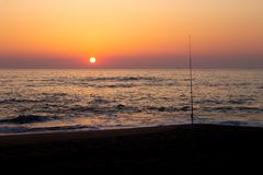 Silhouetted Fishing Pole stock photography