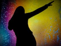 Silhouetted Girl Dancing stock photo
