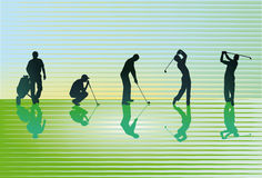 Silhouetted golfers Royalty Free Stock Photography
