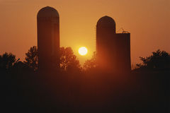 Silhouetted grain elevator Stock Photos