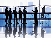 Silhouetted group of business people Royalty Free Stock Image