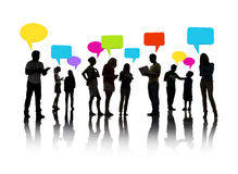 Silhouetted group of people speech bubbles concept Stock Photos