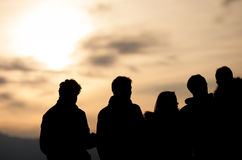 Silhouetted group in sunset sky. Silhouetted group of people in sunset sky Stock Photography