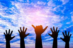 Silhouetted of hand photo. Hand show up in to sky. With sunset. Hand is symbol Comment and democratic royalty free stock photo