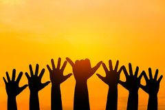 Silhouetted of hand photo. Hand show up in to sky. With sunset. Hand is symbol Comment and democratic royalty free stock photos