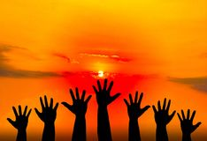Silhouetted of hand photo. Hand show up in to sky. With sunset. Hand is symbol Comment and democratic stock images