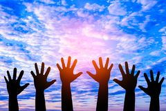 Silhouetted of hand photo. Hand show up in to sky. With sunset. Hand is symbol Comment and democratic stock photos