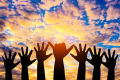 Silhouetted of hand photo. Hand show up in to sky. With sunset. Hand is symbol Comment and democratic royalty free stock images