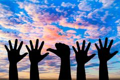 Silhouetted of hand photo. Hand show up in to sky. With sunset. Hand is symbol Comment and democratic royalty free stock photography