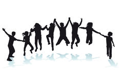 Silhouetted happy children Stock Photo