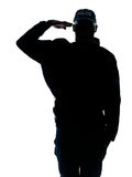 Silhouetted image of policeman saluting Stock Images