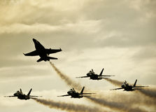 Silhouetted Jets Splitting Off Stock Photography