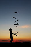 Silhouetted juggler in sunset Royalty Free Stock Image