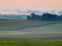 Silhouetted landscape. During sunrise in a hilly landscape Stock Photography