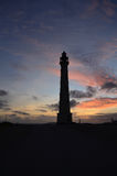 Silhouetted Lighthouse in Noord Aruba at Dawn. Dawn with silhouetted lighthouse in Noord Aruba Royalty Free Stock Photo