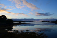 Silhouetted on Loch Dunvegan in Scotland. A pretty look at silhouetted land on Loch Dunvegan in Scotland Royalty Free Stock Images