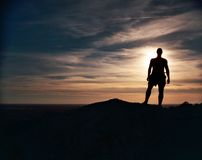 Silhouetted Man. Stands as the sun sets over the Oklahoma landscape Royalty Free Stock Image