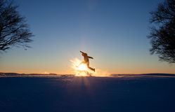 Silhouetted man running in winter landscape Royalty Free Stock Image