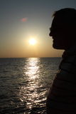 Silhouetted man and sea royalty free stock image
