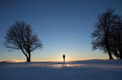 Silhouetted man standing in winter landscape Royalty Free Stock Images