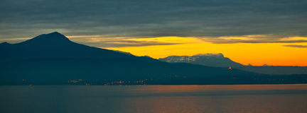 Silhouetted Mountain. Chablais Alps silhoutted against the dawn sunrise Stock Image