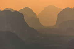 Silhouetted mountains. At dusk in the Krabi province, Thailand Stock Photos