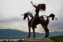 Silhouetted Native Sculpture in Osoyoos, British Columbia, Canada. Closeup shot of native sculpture making offering during sunset in southwestern Canada Royalty Free Stock Photos