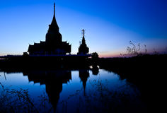Silhouetted of pagoda Stock Images