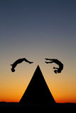 Silhouetted parkour traceurs Stock Photo