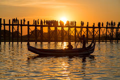Silhouetted people on U Bein Bridge at sunset, Amarapura, Mandal Royalty Free Stock Photography