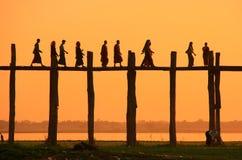 Silhouetted people on U Bein Bridge at sunset, Amarapura, Myanma Royalty Free Stock Image