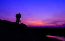 Silhouetted of photographer Royalty Free Stock Image