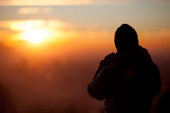 Silhouetted photographer in sunset Royalty Free Stock Photos