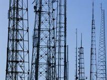Silhouetted radio antennas Stock Photo