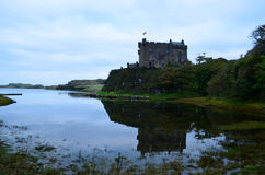Silhouetted Reflection of Dunvegan Castle in Scotland Royalty Free Stock Photos