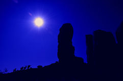 Silhouetted rocks and animals. In the desert Royalty Free Stock Image