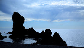 Silhouetted Rocks On Dritvik Beach Royalty Free Stock Images