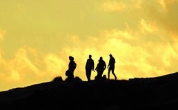 People Silhouetted on Rocky Ridge, Summit Stock Photography