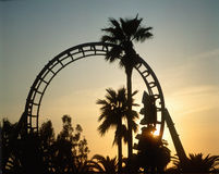 Silhouetted roller coaster at sunset Royalty Free Stock Images