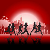Silhouetted runners in front of city background Stock Image