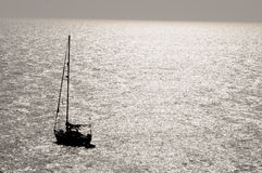 Silhouetted Sailing Boat Stock Images
