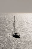 Silhouetted Sailing Boat Stock Photo
