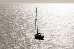 Silhouetted Sailing Boat Stock Photography