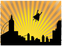 Silhouetted  superhero flying off into the sunset. Flying hero leaving city Silhouetted by large sunset rays Royalty Free Stock Images