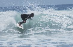 Silhouetted Surfer 3. Surfer silhouetted against wave Royalty Free Stock Images