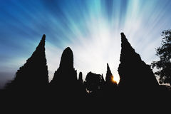 Silhouetted temple with exploding sky Royalty Free Stock Photography