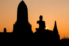 Silhouetted temple and statue of buddha Stock Images