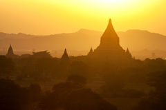 Bagan Temples at Sunset. The silhouetted temples of Bagan at sunset in Myanmar Stock Images